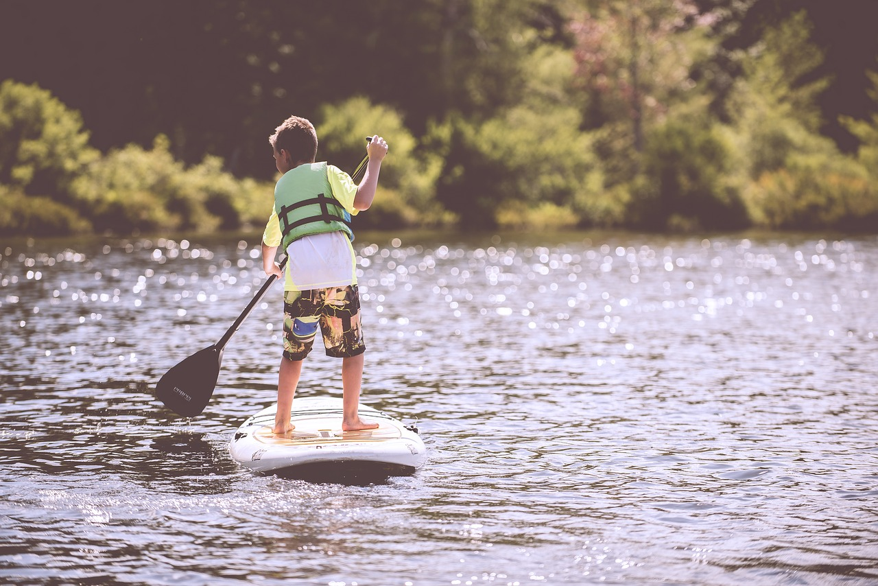kid paddleboarding
